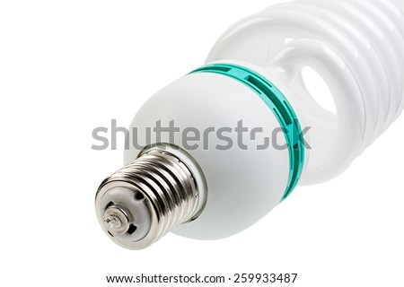Fragment of energy saving lamp close-up. Focus on the lamp cap. Isolated on white background. Clipping path is saved. - stock photo