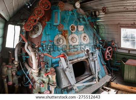 Fragment of engine room on old steam locomotive - stock photo