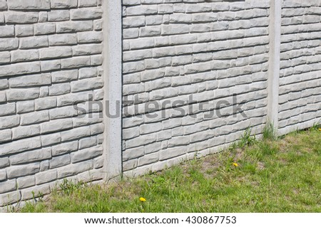 Fragment of grey wall with carving - stock photo