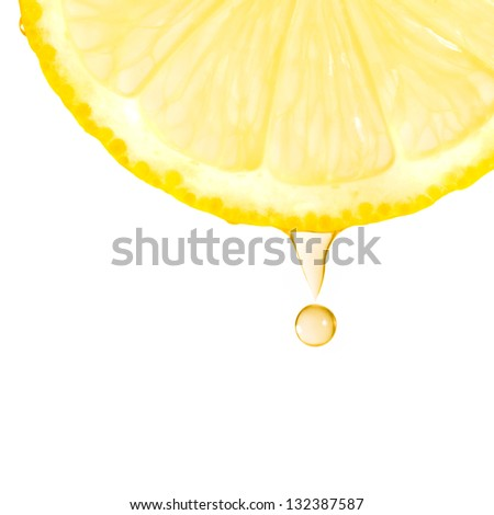 Fragment of lemon with water drops on the white background - stock photo