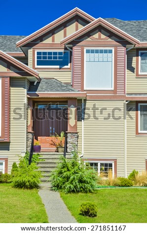 Fragment of luxury residential house with concrete pathway to entrance door. - stock photo