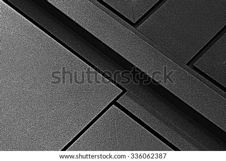 Fragment of metal doors with anti-corrosion protective powder coating. Industrial or technological background. Architectural detail. Abstract geometric black and white composition with strong diagonal - stock photo