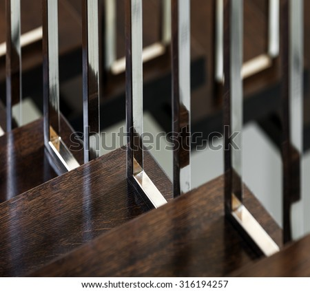 Fragment of new staircase in modern interior - stock photo