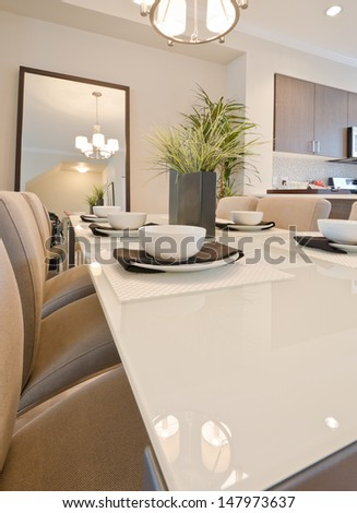 Fragment of nicely decorated and served living, lunch room table with the coffee, tea set. Interior design. Vertical. - stock photo