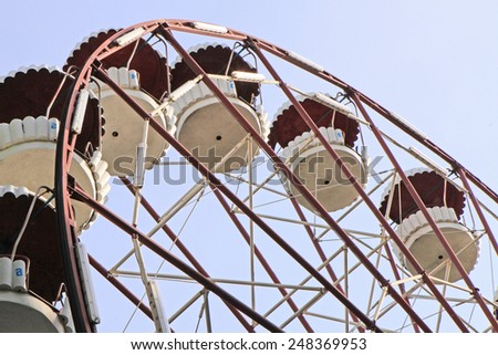Fragment of side-show attraction wheel  - stock photo