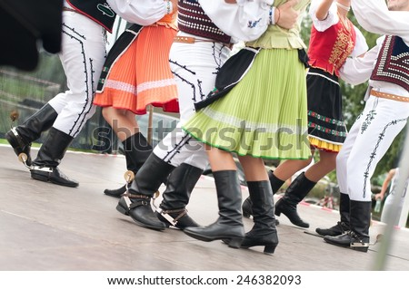 Fragment of Slovak folk dance with colorful clothes in Folk Festival - stock photo