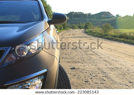 fragment of the car on the road crossover SUV - stock photo