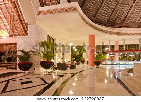 Fragment of the lobby of the five stars luxury caribbean resort hotel. Reception area. Interior design. Bahia Principe, Riviera Maya, Mexican Resort. - stock photo