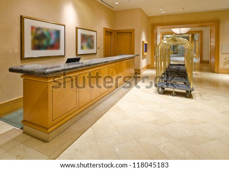 Fragment of the lobby of the luxury five stars hotel with the luggage carts and the counter. - stock photo