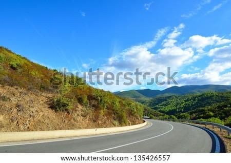 Fragment of the mountain road. Sardinia. Italy - stock photo
