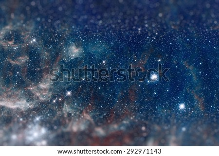 Fragment of the region 30 Doradus lies in the neighboring Large Magellanic Cloud galaxy. Retouched image with small DOF. Blue toning. Elements of this image furnished by NASA. - stock photo