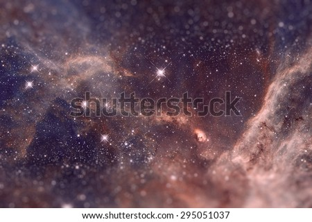 Fragment of the region 30 Doradus lies in the neighboring Large Magellanic Cloud galaxy. Retouched image with small DOF. Marsala toning. Elements of this image furnished by NASA. - stock photo