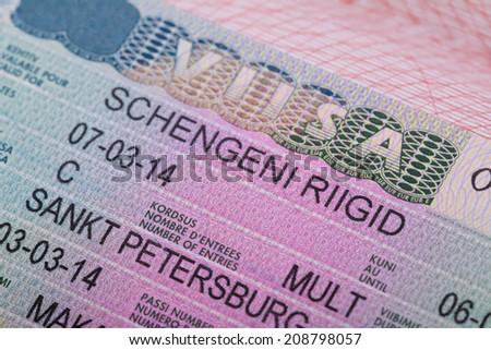 Fragment of the Schengen visa of Estonia in the passport - stock photo