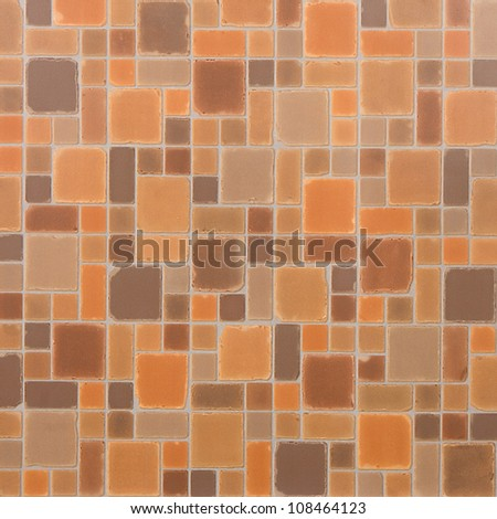 Fragment of tile with orange and beige squares - stock photo