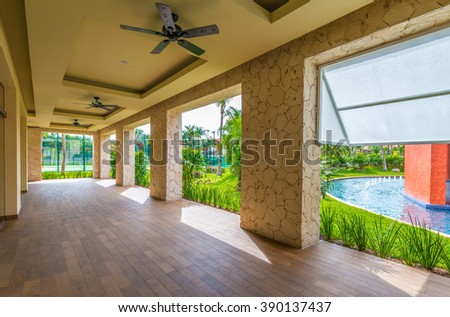 Fragment of urban architecture of caribbean, tropical style gallery, promenade, building, hotel. Interior, exterior design. - stock photo