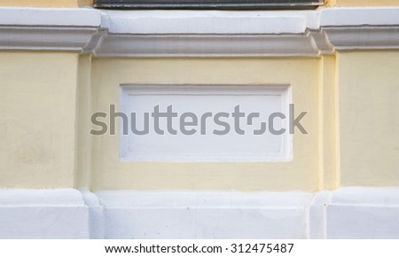 Fragment of yellow plastering wall with white pattern. - stock photo