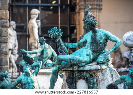 Fragment sculpture of famous Fountain of Neptune on Piazza della Signoria in Florence, Italy - stock photo