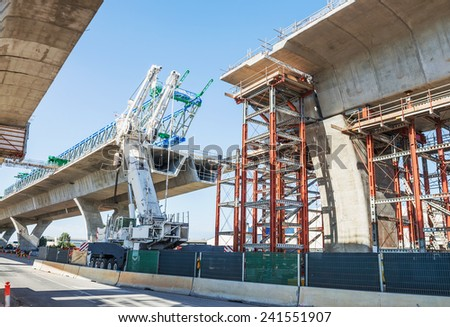 fragment  view  of the road under construction - stock photo