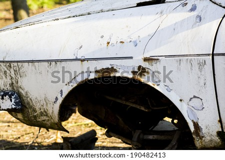Fragments of an old, abandoned, rusty, romanian car - stock photo