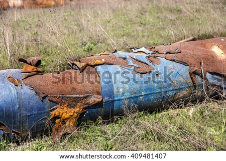 Fragments of old large water pipes. After many years of operation, corroded metal pipe destroyed. Rusty steel tube with holes metal corrosion. Selective focus. - stock photo