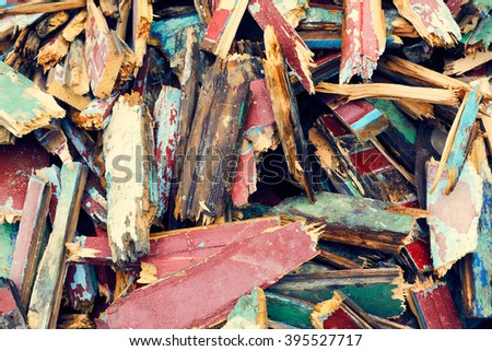 Fragments of old painted broken wooden colorful planks boards kindling texture background - stock photo