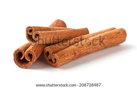 Fragrant cinnamon sticks isolated on white background - stock photo