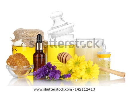 Fragrant honey spa with oils and honey isolated on white - stock photo