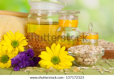 Fragrant honey spa with oils and honey on wooden table close-up - stock photo