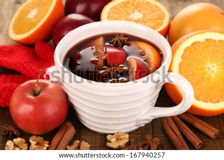 Fragrant mulled wine in bowl on wooden table close-up - stock photo