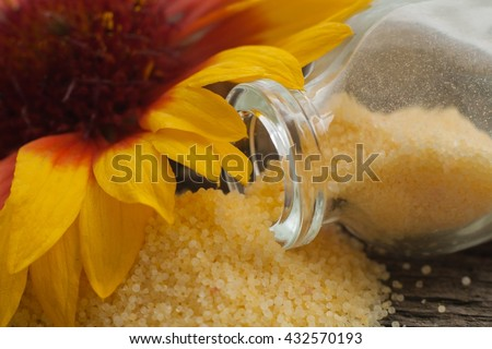 Fragrant salt for bathing . Small small bottles with salt .Relaxation after work of the house . A sauna for health . To take a bath . Beauty shop . For women . Natural ingredient . Yellow salt .  - stock photo