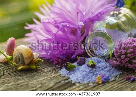 Fragrant salt for bathing  . Small small bottles with salt. Relaxation after work of the house. A sauna for health . Beauty shop. For women.  Salt with aroma of flowers. Abundance of aromas for a ba - stock photo
