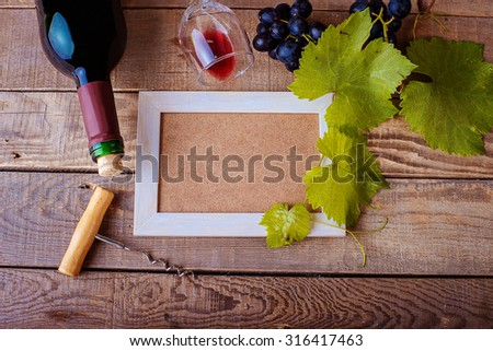 frame design with grapes and a bottle of red wine - stock photo