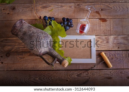 frame design with grapes and a bottle of red wine. background and texture - stock photo