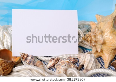 Frame for photo on a sea blue background with shell - stock photo