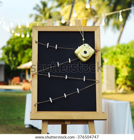 Frame for Polaroid photos . On the easel stretched rope with clothespins . - stock photo