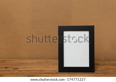 Frame. Frame on a wooden table. Place for your text - stock photo