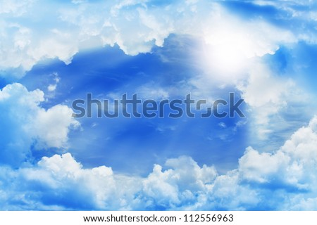 frame of beautiful clouds with blue sky and sun beam. - stock photo