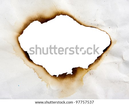 Frame of burned hole in paper - stock photo