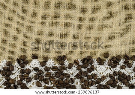 Frame of coffee beans on linen background - stock photo