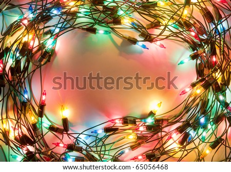 Frame of colorful Christmas lights. Decorative garland - stock photo