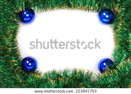Frame of green Christmas garland with blue balls on a white background - stock photo