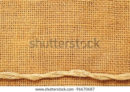 frame of ropes on sack - stock photo