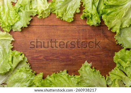 Frame of salad on old wooden table - stock photo