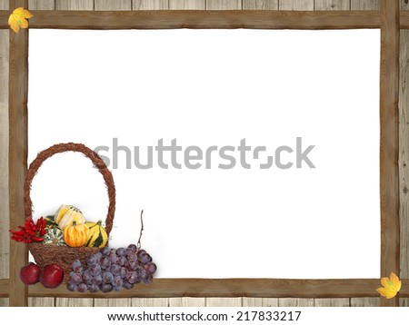 frame of wooden planks and autumnal maple leaves, thanksgiving basket, white copy space - stock photo