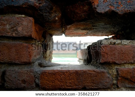 Frame out of red old bricks in Toulouse wall - stock photo