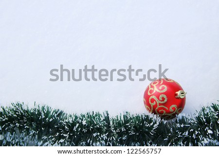 frame with a toy in the snow - stock photo