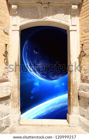 Frame with ancient door and space scene - stock photo