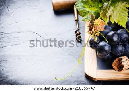 Frame with fresh grapes and corkscrew. Winemaking concept  - stock photo