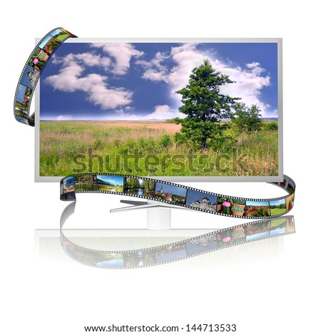 Frames of film on the display with image of landscape - stock photo
