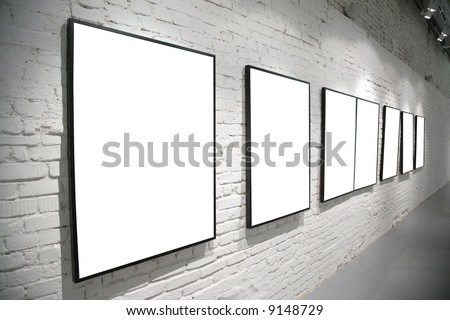 frames on brick white wall - stock photo